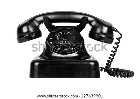 Old vintage phone isolated on white background - stock photo