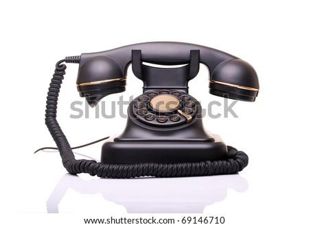 old vintage phone on white - stock photo