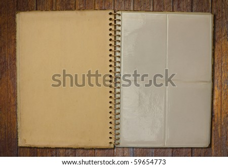 old vintage photo album on wood wall - stock photo