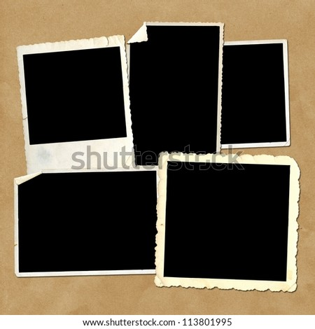 Old vintage photo frames on cardboard background - stock photo