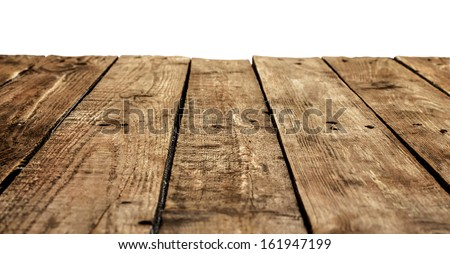 Old vintage planked wood table in perspective on white background - stock photo