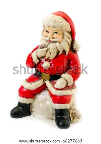Old vintage porcelain Santa Claus on white background with copy space - stock photo