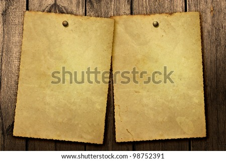 Old vintage poster on wooden background - stock photo