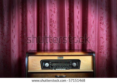 Old vintage radio with city names on red background! Ideal for concept photo - stock photo
