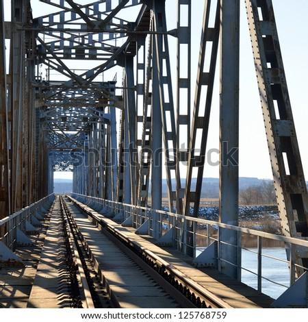 Old vintage railway bridge over river - stock photo