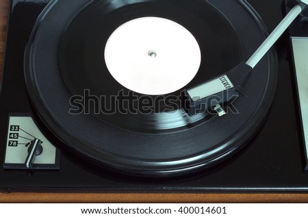 Old vintage record player playing vinyl record with pink label. Top view horizontal photo view  - stock photo