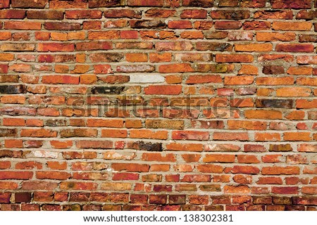 Old vintage red brick wall background - stock photo
