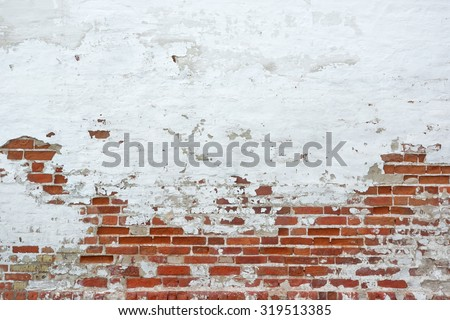 Old Vintage Red Brick Wall With Sprinkled White Plaster Texture Background - stock photo