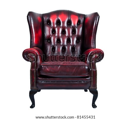 Old vintage red leather chair isolated on white background - stock photo