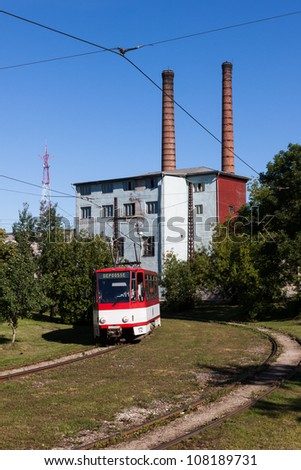 Old vintage red tram on the street of Tallinn, Estonia. Going to depot - stock photo