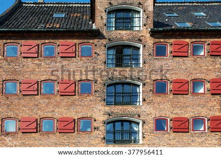Old vintage retro brick houses in in old part of town in Copenhagen, Denmark - stock photo