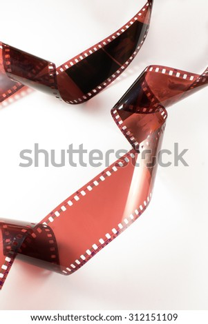 Old, vintage, retro film strip. Negative frame, picture, photography. Isolated on white background. - stock photo