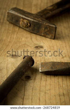 old vintage retro used tools on wooden table - stock photo