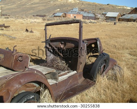 old vintage rusty car in need or repair - stock photo