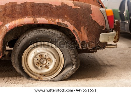 Old vintage rusty car showing detail from the back. - stock photo