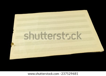 old vintage sheet of music paper isolated on black background