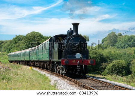 old vintage steam train with green wagons - stock photo