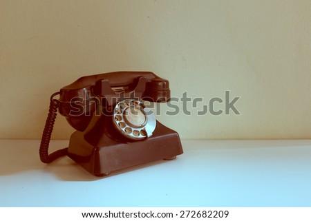 Old vintage telephone - stock photo