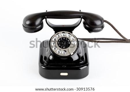 Old vintage telephone on white background - stock photo