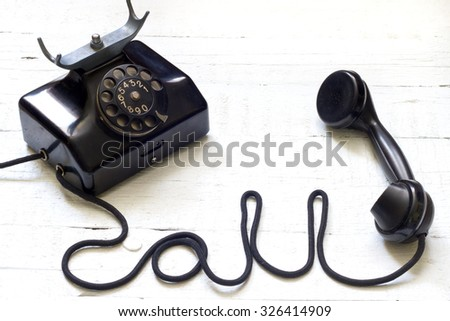 Old vintage telephone with call sign letters abstract concept - stock photo