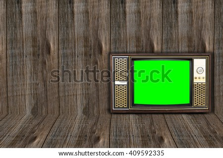 Old vintage television on Wood texture background. - stock photo