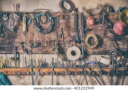 Old vintage tools on the wall - stock photo