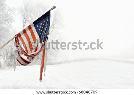 Old Vintage torn American Flag with frost and snow - stock photo