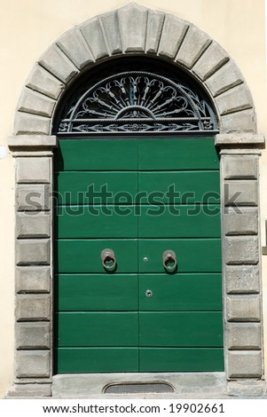 Old vintage Tuscany door entrance - stock photo