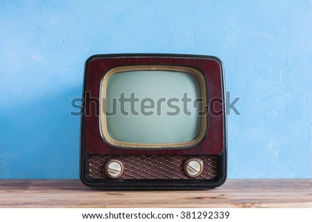Old vintage TV with wooden case - stock photo