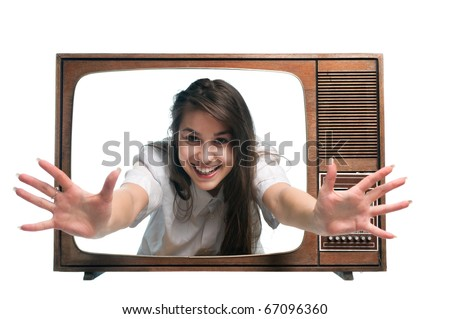 Old vintage tv with young woman arms outstretched from screen - stock photo
