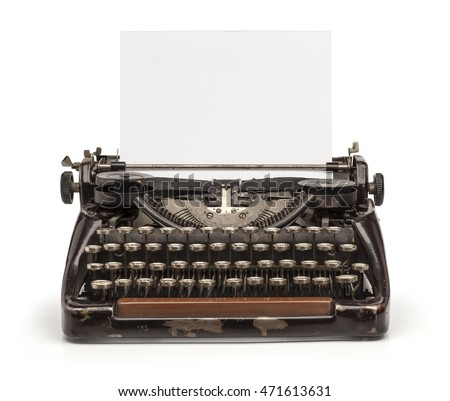 Old vintage typewriter and a blank sheet of paper inserted. Isolated on white background.