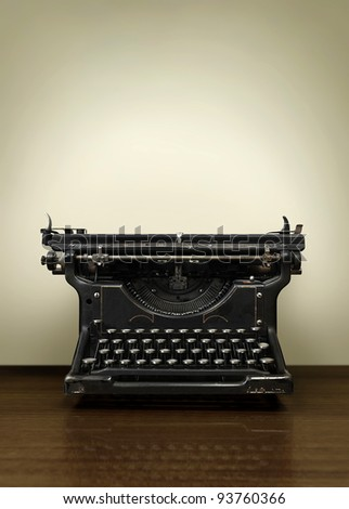 Old Vintage Typewriter on wooden Office desk - stock photo