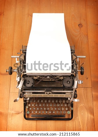 Old vintage typewriter with a blank letter - stock photo