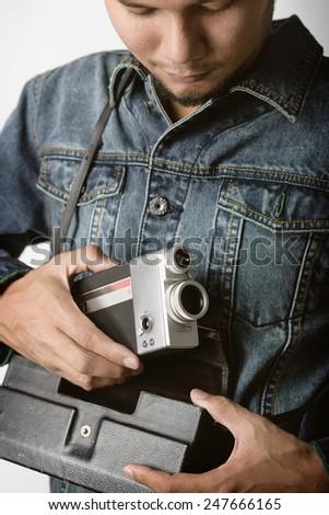 old vintage VDO camera in hand - stock photo