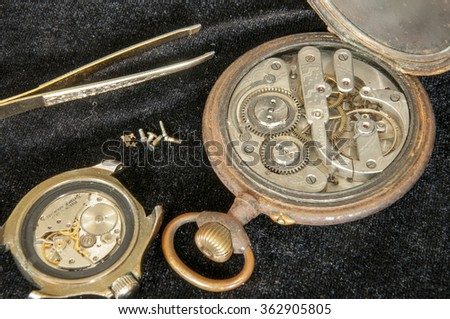 old, vintage watches on black background - stock photo