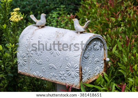 Old vintage white postbox with flowers pattern - stock photo