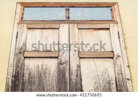 Old vintage windows  in concrete wall