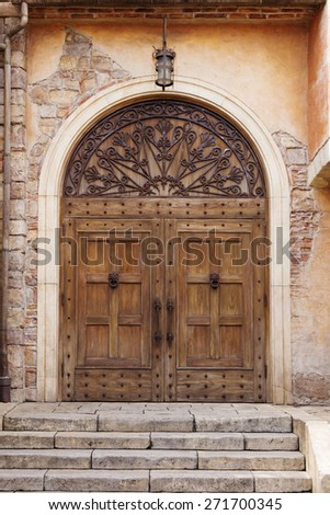 old vintage wooden door with italian style wall and stair - stock photo