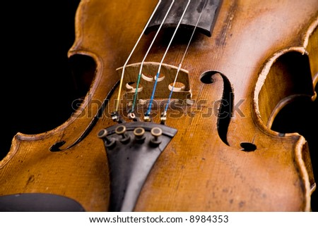 old violin close-up isolated on black background