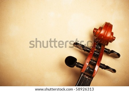 old violin detail on paper with copy-space - stock photo