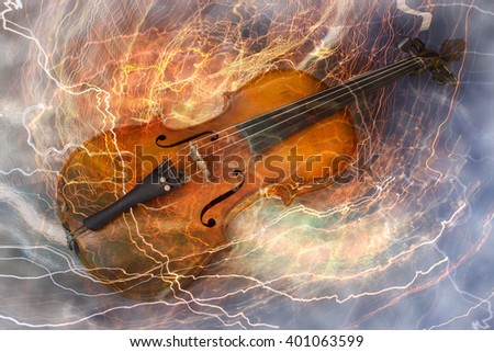 Old violin music concept with lighting effect - stock photo