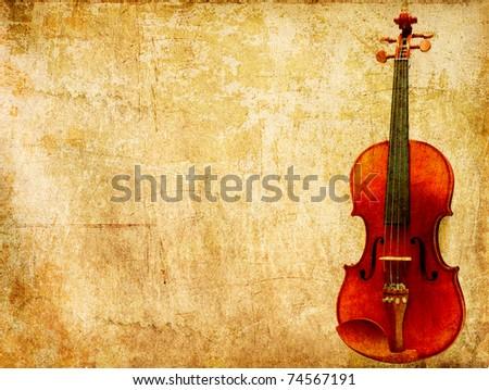 Old violin on vintage grunge paper - stock photo