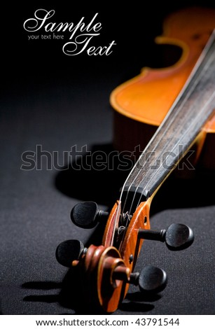 Old violin. Space for text isolated on black - stock photo