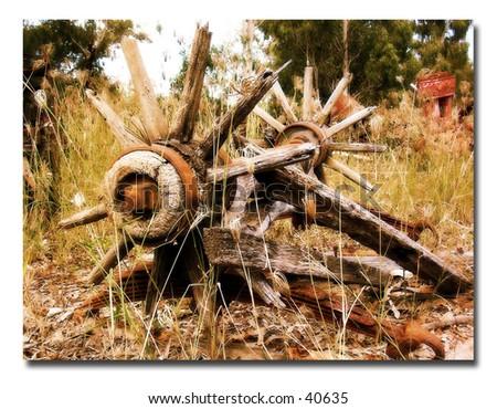 Old wagon wheels - stock photo