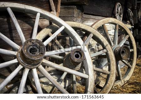 old wagon wheels at a farm - stock photo