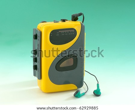 old Walkman on green background
