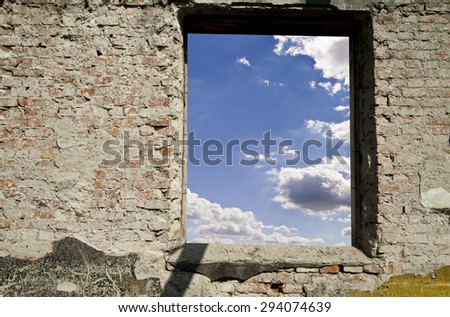 old wall and blue sky with clouds - stock photo