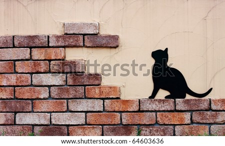 Old wall and cat - stock photo