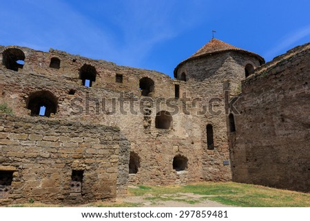 Old wall and tower of Belgorod-Dnestrovsky castle - stock photo