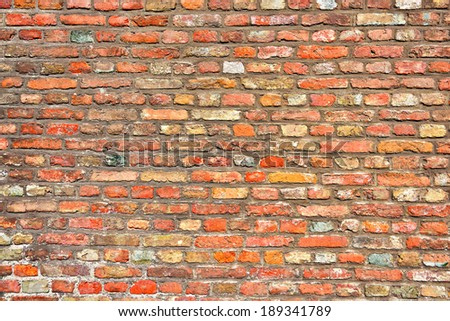 Old wall built from red bricks - stock photo